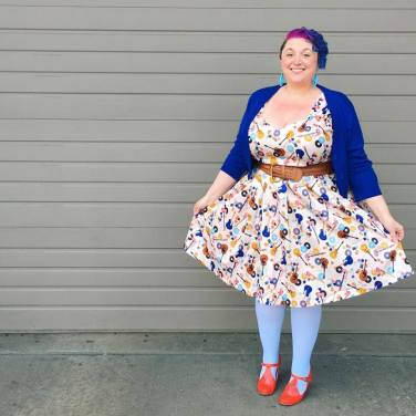 Cardigan: Pinup Girl Clothing, Dress: Lindy Bop, Belt: Ross, Tights: We Love Colors, Shoes: ModCloth, Earrings: It's Fashion Metro