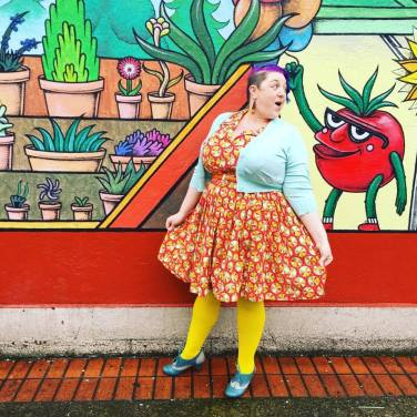 Cardigan: Pinup Girl Clothing, Dress: ModCloth, Earrings: Cato, Tights: We Love Colors, Shoes: Chelsea Crew